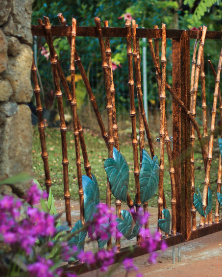 Custom metal bamboo-style tropical gate by Kipu Forge
